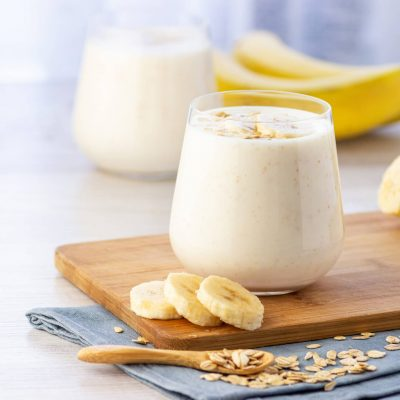Vegan Banana And Oatmeal Smoothie In Glass Jar On The Light Background.