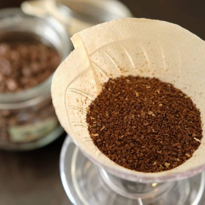 Ground Coffee Beans And Coffee Beans In A Preservation Jar