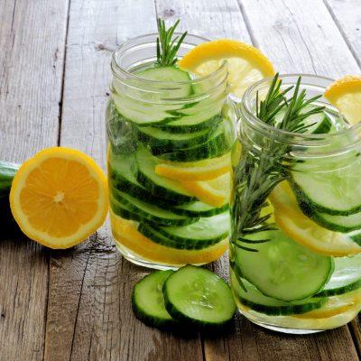 Mason Jars Of Detox Water With Lemon, Cucumber On Wood