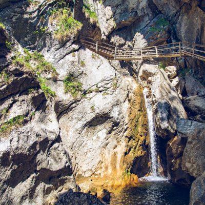 View at waterfall path along mountain stream. Tourist spot. Travel destination