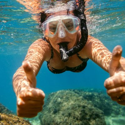 Woman snorkelling under water.